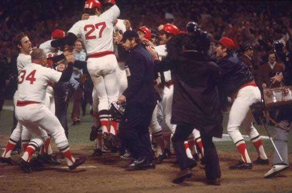 """<p><strong>October 21, 1975</strong>: In the twelfth inning of Game 6 of the 1975 World Series, Boston catcher Carlton Fisk led off by sending Reds pitcher Pat Darcy's second offering deep to left. There was no question the ball would leave the yard, only on which side of the foul pole. Fisk took three sidestepping leaps toward first base, all the while waving his arms, as if trying to force the ball to stay fair. On the fourth leap, he thrust his fists into the air. """"The visual is key there,"""" said Richard Puerzer, a member of the Society for American Baseball Research. """"The camera angle that they had showing him waving it fair was something that they didn't usually have.""""<br> </p>"""