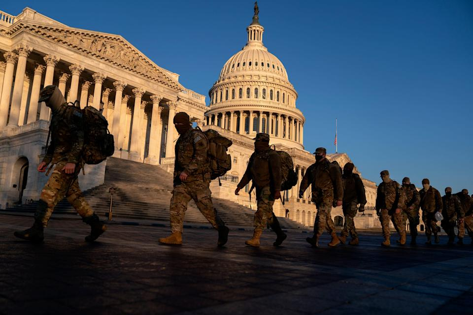 Members of the National Guard gather outside the U.S. Capitol on Jan. 12, 2021 in Washington, DC. Today the House of Representatives plans to vote on Rep. Jamie Raskin's (D-MD) resolution calling on Vice President Mike Pence to invoke the 25th Amendment, removing President Trump from office. Wednesday, House Democrats plan on voting on articles of impeachment.