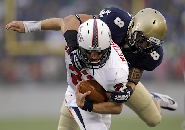 South Alabama quarterback Ross Metheny (2) tries to break loose from Navy safety Wave Ryder (8) as he is tackled in the first half of an NCAA college football game in Annapolis, Md., Saturday, Nov. 16, 2013. (AP Photo/Patrick Semansky)