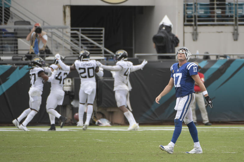 Philip Rivers (17) walks off the field after the Jaguars intercepted him, one of two picks the quarterback tossed in the Week 1 defeat. Next up for the Colts: the 0-1 Vikings. (AP Photo/Phelan M. Ebenhack)