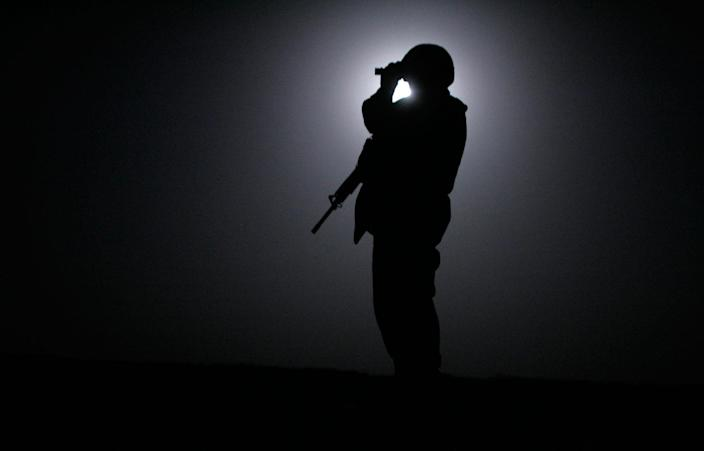 <p>A Marine from the 3rd Battalion, Fourth Marines scans the horizon with night vision goggles while silouetted by the moon during midnight patrol around Camp Mercury, the former Camp Abu Ghraib, June 23, 2005 in Anbar province, Iraq. Marines from the 3/4 embark on risky night patrols around their base in one of Iraq's most dangerous zones to prevent attacks and keep insurgents at bay. (Photo by Chris Hondros/Getty Images) </p>