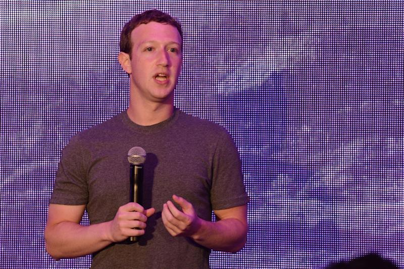 Facebook founder Mark Zuckerberg writes that for every 10 people connected to the Internet, one is lifted out of poverty (AFP Photo/Romeo Gacad)