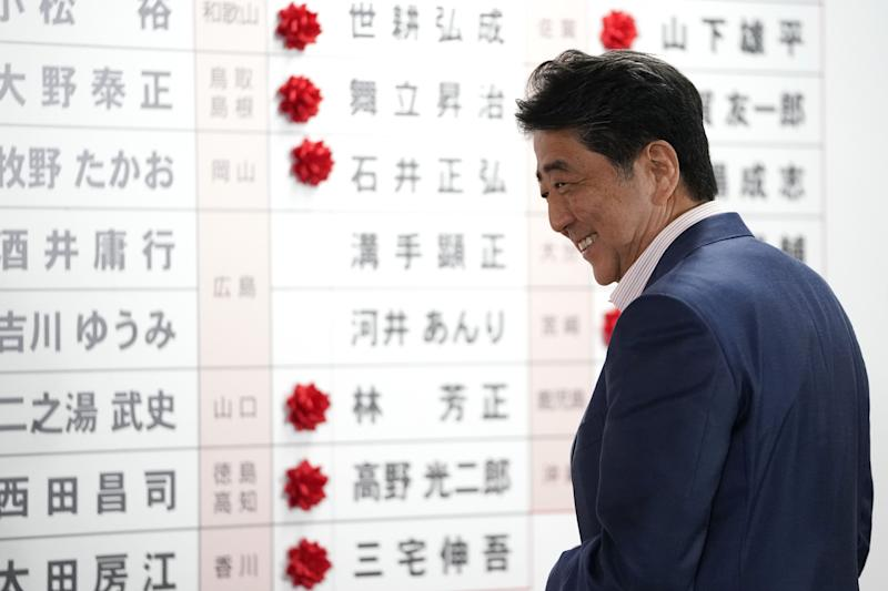 """(Bloomberg) -- Japanese Prime Minister Shinzo Abe claimed victory in Sunday's upper house election while falling short of securing a supermajority to quickly push through his plans to make the first revisions to the country's pacifist constitution.With the final vote tally not yet complete, Abe's Liberal Democratic Party and its partner Komeito have won at least 69 of the 124 seats up for grabs, public broadcaster NHK projected. Given the 70 seats they hold in the uncontested section of the chamber, this amounts to a simple majority of the total 245 seats.Abe, on course to be Japan's longest-serving prime minister in November, said the vote showed the public approved of his government's guidance of the world's third-largest economy. """"Everyone said it would be no easy task to get a majority while promising a tax hike, but I think we were able to get the public's understanding,"""" he told NHK.He and other proponents of constitutional change fell short of the 85 seats that would have given them a two-thirds majority needed to send any proposed constitutional revision to a national referendum, NHK said.Abe believes he can convince lawmakers to change their minds. """"The two-thirds majority needed for constitutional reform is something we want to build from here on in through debate in parliament's constitutional commissions,"""" he told NHK.Abe wants to add wording that makes explicit the legality of Japan's Self-Defense Forces to the war-renouncing Article 9 of the constitution -- though this idea divides the electorate. The document has remained unchanged since it was enacted in the aftermath of World War II.Tax HikeThe sales tax increase is intended to help rein in the globe's biggest debt load, which stems from increased social welfare spending for Japan's rapidly aging population. The government has raised the tax twice since it was introduced in 1989, and both times saw an economic slide.Even though the tax hike was opposed by 57% of respondents to NHK's exit poll Sunday"""