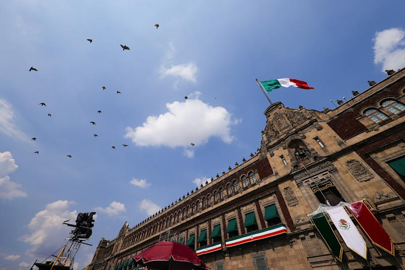 "MEXICO CITY, MEXICO - SEPTEMBER 15: General view of Palacio Nacional during the Independence Day celebrations on September 15, 2020 in Mexico City, Mexico. This year El Zocalo square remains closed for general public due to coronavirus restrictions. Every year the president marks the ""Grito de Dolores"" to commemorate the 1810 call to arms made by priest Miguel Hidalgo which began the struggle for independence from Spain finally achieved in 1821. (Photo by Hector Vivas/Getty Images)"