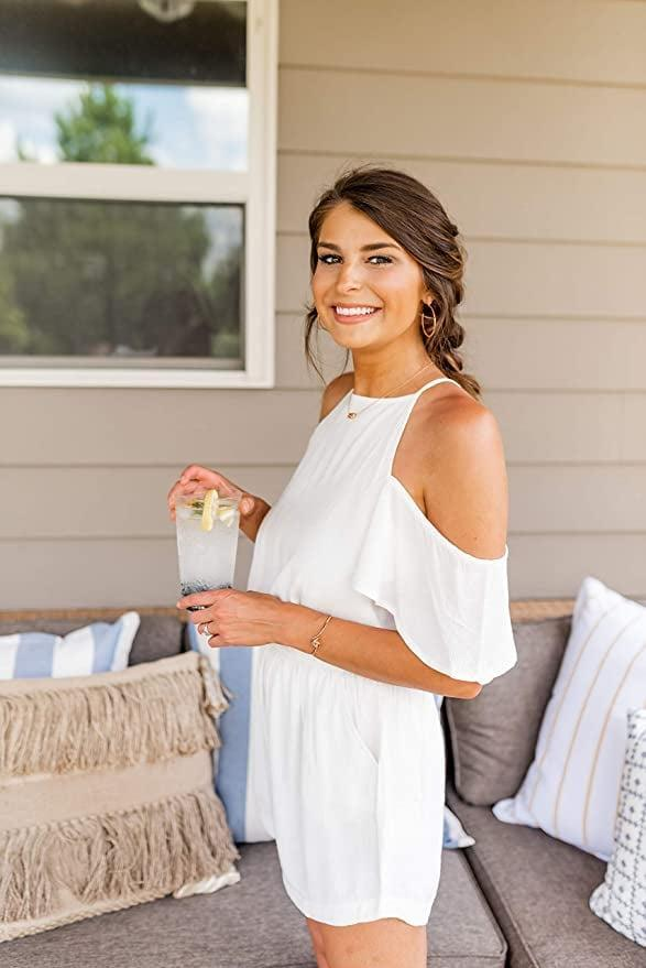 <p>This <span>Mud Pie White Romper</span> ($31) looks flowy and easygoing.</p>