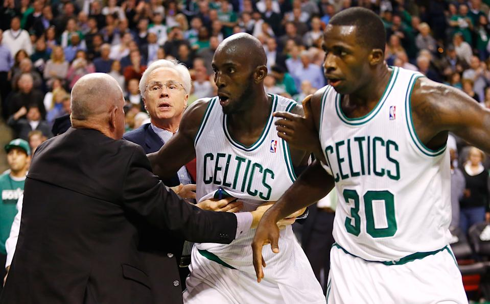 BOSTON, MA - NOVEMBER 28: Kevin Garnett #5 and Brandon Bass #30 of the Boston Celtics are held back by coaches during a fight with members of the Brooklyn Nets during the game on November 28, 2012 at TD Garden in Boston, Massachusetts.
