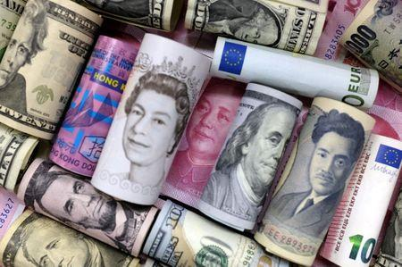 Euro, Hong Kong dollar, U.S. dollar, Japanese yen, pound and Chinese 100 yuan banknotes are seen in this picture illustration