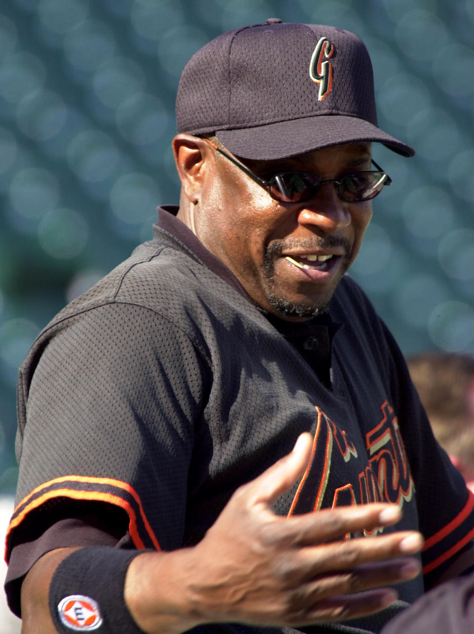 FILE - In this Oct. 11, 2002, file photo, San Francisco Giants manager Dusty Baker gestures during practice at Pac Bell Park in San Francisco. In 1993, Bakers Giants went 103-59 but missed the playoffs by a single game after a memorable division race with the Atlanta Braves (there were no wild cards in those days). Over 22 years, Baker has guided four teams to the playoffs and notched 1,863 wins. But his career is marred by its postseason failures. (AP Photo/Elaine Thompson, File)