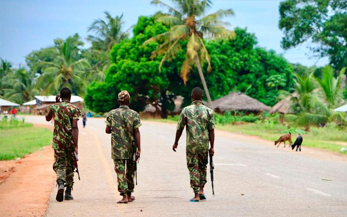 Soldiers from the Mozambican army patrol the streets after security in the area was increased, following a two-day attack from suspected islamists in October last year in Mocimboa da Praia - AFP