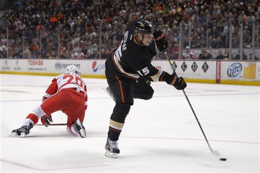 Anaheim Ducks center Ryan Getzlaf, right, shoots and scores as Detroit Red Wings left wing Drew Miller falls to the ice during the second period of their NHL hockey game, Sunday, March 24, 2013, in Anaheim, Calif. (AP Photo/Mark J. Terrill)