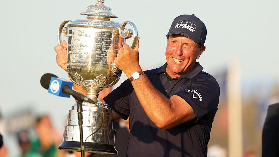 Seen here, Phil Mickelson holds the PGA Championship trophy aloft.