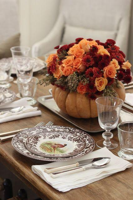 """<p>Use seasonal autumn flowers such as broom cob, roses, and mums to fill your DIY pumpkin vase. </p><p><strong>Get the tutorial at <a href=""""http://jennysteffens.blogspot.com/2012/11/diy-thanksgiving-centerpiece-roses-mums.html"""" rel=""""nofollow noopener"""" target=""""_blank"""" data-ylk=""""slk:Everyday Occasions"""" class=""""link rapid-noclick-resp"""">Everyday Occasions</a>.</strong></p><p><a class=""""link rapid-noclick-resp"""" href=""""https://www.amazon.com/artificial-flowers/b?ie=UTF8&node=14087331&tag=syn-yahoo-20&ascsubtag=%5Bartid%7C10050.g.2130%5Bsrc%7Cyahoo-us"""" rel=""""nofollow noopener"""" target=""""_blank"""" data-ylk=""""slk:SHOP FAUX FLOWERS"""">SHOP FAUX FLOWERS </a></p>"""
