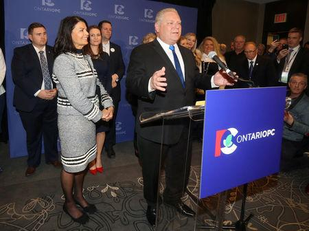 Progressive Conservatives leadership race candidate winner Doug Ford speaks with his wife Karla in Markham, Ontario, Canada, March 10, 2018.   REUTERS/Fred Thornhill