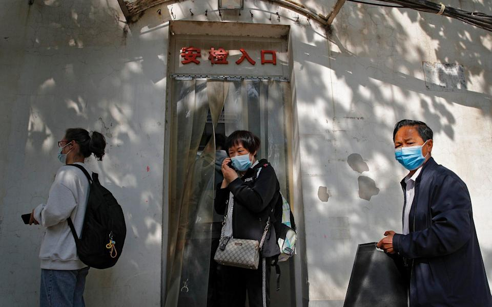 Wei Xiuwen, mother of Chen Mei, centre, heads to the courthouse to attend her child's case in Beijing - Andy Wong/AP