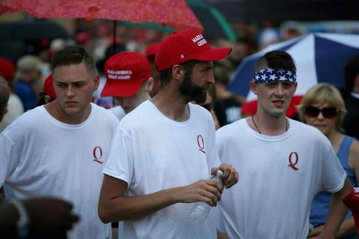 Members of the right-wing QAnon movement are convinced that there is a secret plot against President Donald Trump -- without any credible evidence (AFP Photo/SCOTT OLSON)