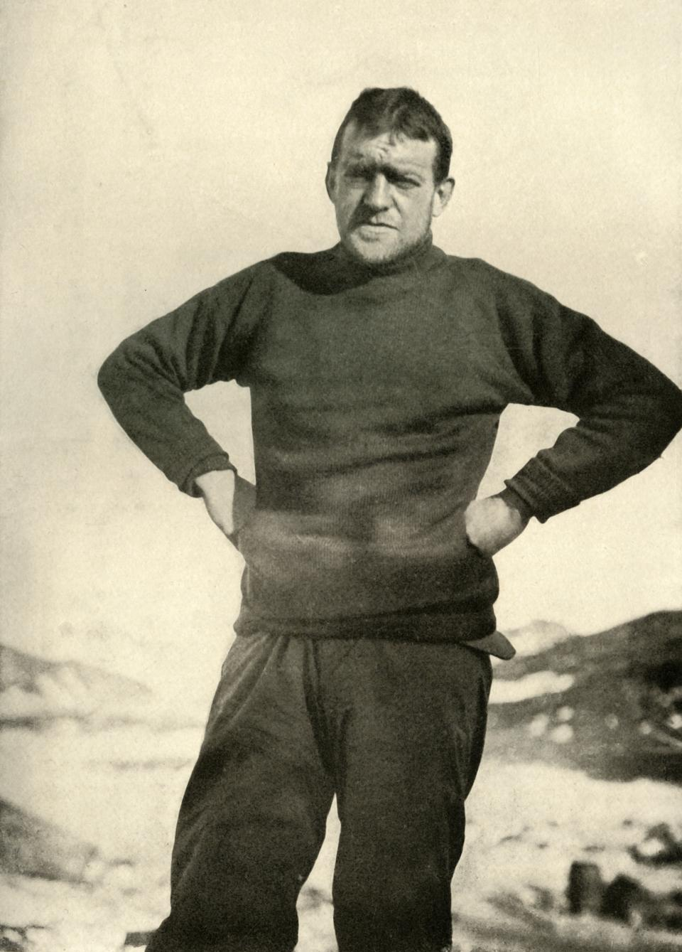 The Leader of the Expedition in Winter Garb', circa 1908, (1909). Anglo-Irish explorer Ernest Shackleton (1874-1922) in a jumper. Shackleton made three expeditions to the Antarctic. During the second expedition, 1907-1909, he and three companions established a new record, Farthest South latitude at 88°S, only 97 geographical miles (112 statute miles, or 180 km) from the South Pole, the largest advance to the pole in exploration history. Members of his team also climbed Mount Erebus, the most active volcano in the Antarctic. Shackleton was knighted by King Edward VII for these achievements. He died during his third and last 'oceanographic and sub-antarctic' expedition, aged 47. Illustration from The Heart of the Antarctic, Vol. I, by E. H. Shackleton, C.V.O. [William Heinemann, London, 1909]. Artist Unknown. (Photo by Print Collector/Getty Images)