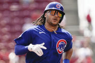 Chicago Cubs' Michael Hermosillo rounds the bases after hitting a two run home run during the second inning of a baseball game against the Cincinnati Reds in Cincinnati, Wednesday, Aug. 18, 2021. (AP Photo/Jeff Dean)