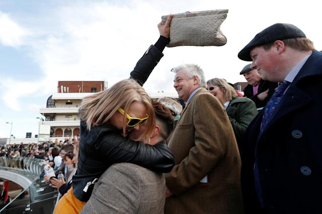 Horse Racing - Cheltenham Festival - Cheltenham Racecourse, Cheltenham, Britain - March 15, 2018 Racegoers celebrates during the 14:50 Ryanair Chase Action Images via Reuters/Andrew Boyers