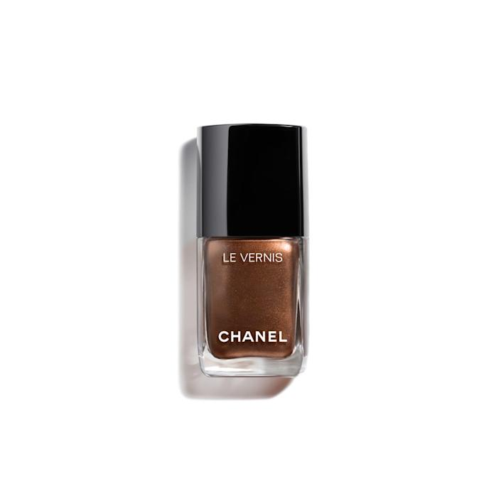 """<p><strong>LE VERNIS</strong></p><p>chanel.com</p><p><strong>$28.00</strong></p><p><a href=""""https://go.redirectingat.com?id=74968X1596630&url=https%3A%2F%2Fwww.chanel.com%2Fus%2Fmakeup%2Fp%2F159899%2Fle-vernis-longwear-nail-colour%2F&sref=https%3A%2F%2Fwww.prevention.com%2Fbeauty%2Fg37105652%2Fbest-fall-nail-colors%2F"""" rel=""""nofollow noopener"""" target=""""_blank"""" data-ylk=""""slk:Shop Now"""" class=""""link rapid-noclick-resp"""">Shop Now</a></p><p>A mix of two trends, Chanel's Solar polish is perfect for fall. It's a <strong>chocolatey brown with """"a high reflection metallic</strong>,"""" notes Elle. The luxury fashion house lives up to its hype with this perfect-for-fall nail polish that's enriched with ceramides to <a href=""""https://www.prevention.com/beauty/g36212270/best-nail-strengthener/"""" rel=""""nofollow noopener"""" target=""""_blank"""" data-ylk=""""slk:help strengthen"""" class=""""link rapid-noclick-resp"""">help strengthen</a> and improve the condition of nails over time.</p>"""