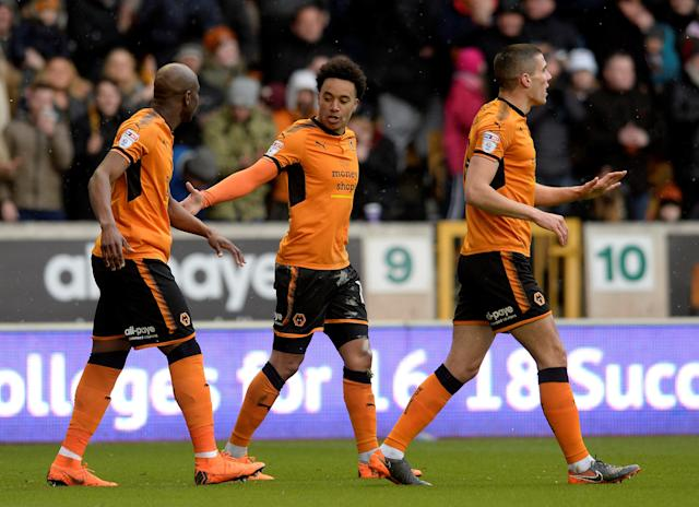"Soccer Football - Championship - Wolverhampton Wanderers vs Burton Albion - Molineux Stadium, Wolverhampton, Britain - March 17, 2018 Wolves' Helder Costa celebrates scoring their first goal with team mates Action Images/Alan Walter EDITORIAL USE ONLY. No use with unauthorized audio, video, data, fixture lists, club/league logos or ""live"" services. Online in-match use limited to 75 images, no video emulation. No use in betting, games or single club/league/player publications. Please contact your account representative for further details."