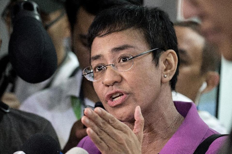 Reporters working for Maria Ressa's Rappler news site, which has been critical of President Duterte's drug war, were banned from all of the Philippine leader's public events last year (AFP Photo/NOEL CELIS)