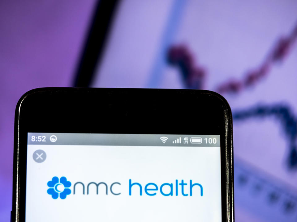 UKRAINE - 2019/03/16:  In this photo illustration, the NMC Health PLC logo seen displayed on a smartphone. (Photo Illustration by Igor Golovniov/SOPA Images/LightRocket via Getty Images)