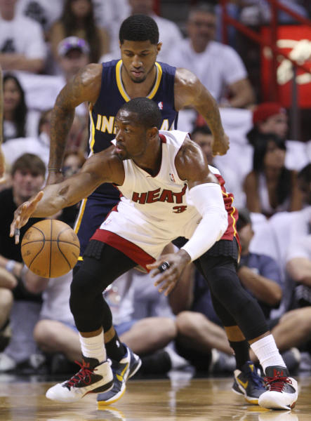 Miami Heat guard Dwyane Wade, foreground, regains control of the ball as he is guarded by Indiana Pacers guard Paul George, rear, during the first half of Game 2 in an NBA basketball Eastern Conference semifinal playoff series, Tuesday, May 15, 2012, in Miami. (AP Photo/Wilfredo Lee)