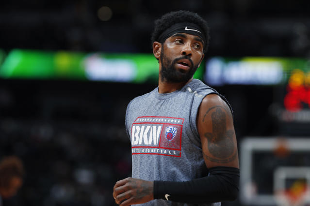 Nets point guard Kyrie Irving will miss Sunday's game but should return soon from a shoulder injury. (AP Photo/David Zalubowski)
