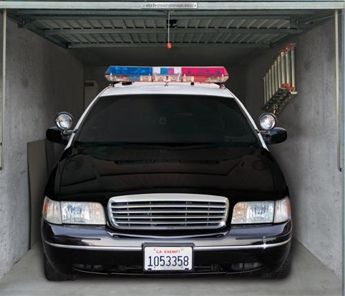 "<b>Police car</b><br> (Price: $229)<br><br>  Credit: <a href=""https://www.style-your-garage.com/us/Garage-mural/?cur=3"">style-your-garage.com</a>"