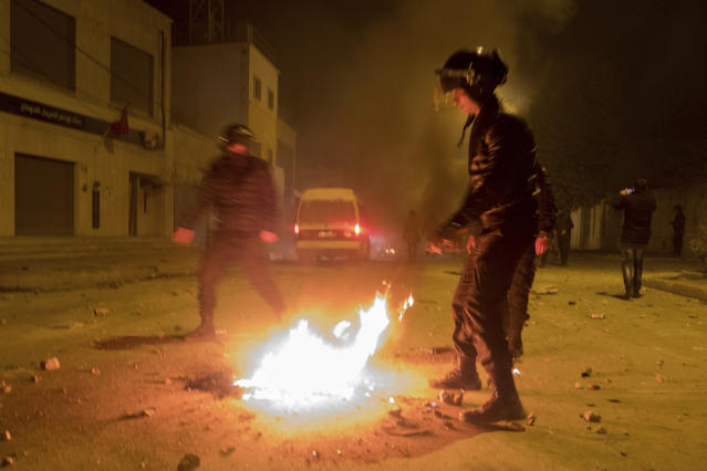 <p>Riot police hold their positions near a fire after clashes with demonstrators in Tebourba, south of the Tunisian capital, Tunis, Jan. 9, 2018. (Photo: Amine Landoulsi/AP) </p>