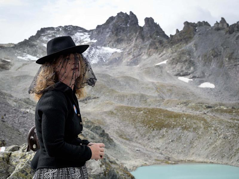 """A woman takes part in a ceremony to mark the """"death"""" of the Pizol glacier above Mels, eastern Switzerland: AFP/Getty Images"""
