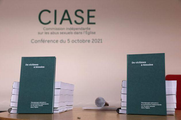 A picture shows copies of the report displayed on a table during the publishing of a report by an independant commission into sexual abuse by church officials (Ciase) on October 5, 2021, in Paris. - The commission's two and a half years of research based on church, court and police archives, as well as interviews with witnesses, uncovered between 2,900 and 3,200 paedophile priests or other members of the church have operated inside the French Catholic Church since 1950. (Photo by THOMAS COEX / POOL / AFP) (Photo by THOMAS COEX/POOL/AFP via Getty Images) (Photo: THOMAS COEX via Getty Images)