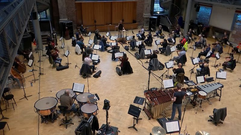 A socially-distanced London Symphony Orchestra rehearse in London