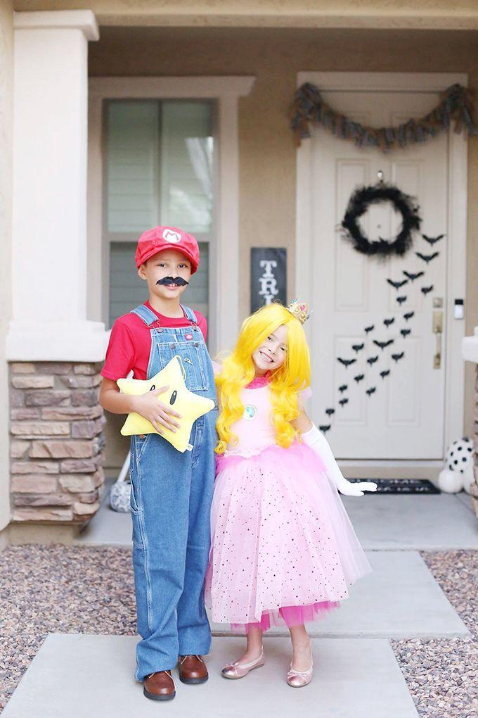 """<p>Make way for <a href=""""https://seevanessacraft.com/2019/10/super-mario-family-halloween-costumes/"""" rel=""""nofollow noopener"""" target=""""_blank"""" data-ylk=""""slk:Mario"""" class=""""link rapid-noclick-resp"""">Mario</a> and Princess Peach on Halloween! Put your sibling rivalry aside with these adorable costumes.<br></p>"""