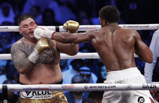 Defending champion Andy Ruiz Jr., left, takes a jab to the face during his fight against Britain's Anthony Joshua in their World Heavyweight Championship contest at the Diriyah Arena, Riyadh, Saudi Arabia. (AP Photo/Hassan Ammar)