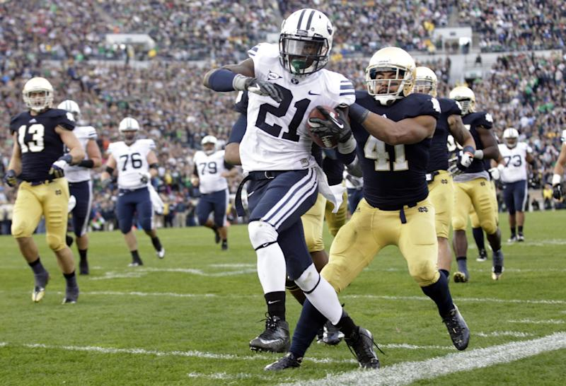 BYU running back Jamaal Williams (21) is knocked out-of-bounds after a 21-yard gain by Notre Dame safety Matthias Farley, right, and defensive end Sheldon Day during the first half of an NCAA college football game in South Bend, Ind., Saturday, Oct. 20, 2012. (AP Photo/Michael Conroy)