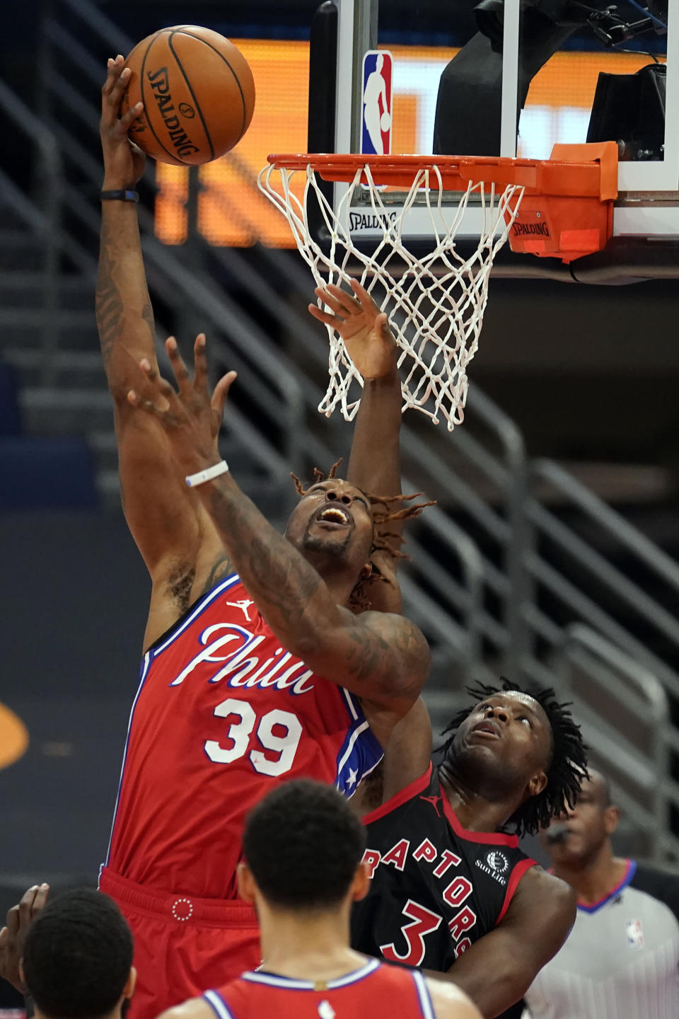 Philadelphia 76ers center Dwight Howard (39) shoots over Toronto Raptors forward OG Anunoby (3) during the first half of an NBA basketball game Sunday, Feb. 21, 2021, in Tampa, Fla. (AP Photo/Chris O'Meara)