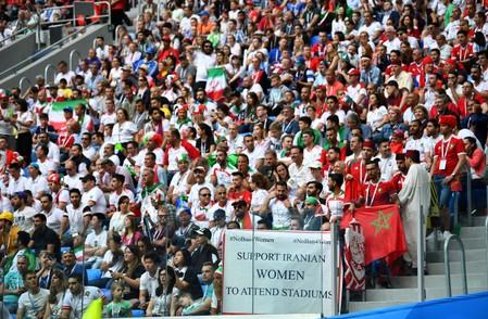 FILE PHOTO: General view of a banner displayed referencing Iranian women during a World Cup match