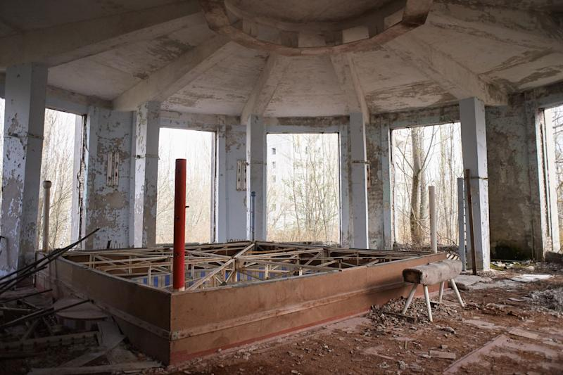 "An interior view in abandoned building of culture ""Energetic"" in the Pripyat, near the Chernobyl nuclear power plant in the Exclusion Zone, Ukraine. (Photo: Vitaliy Holovin/Corbis via Getty images)"