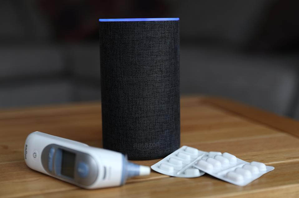 A general view of an Amazon Echo smart speaker alongside an ear thermometer and some pills. Amazon's Alexa is set to answer people's health queries by searching the official NHS website. (Photo by Andrew Matthews/PA Images via Getty Images)