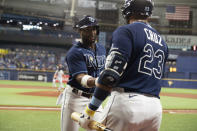 Tampa Bay Rays' Yandy Diaz, left, celebrates with Nelson Cruz after hitting a home run against the Detroit Tigers during the first inning of a baseball game Thursday, Sept. 16, 2021, in St. Petersburg, Fla. (AP Photo/Scott Audette)
