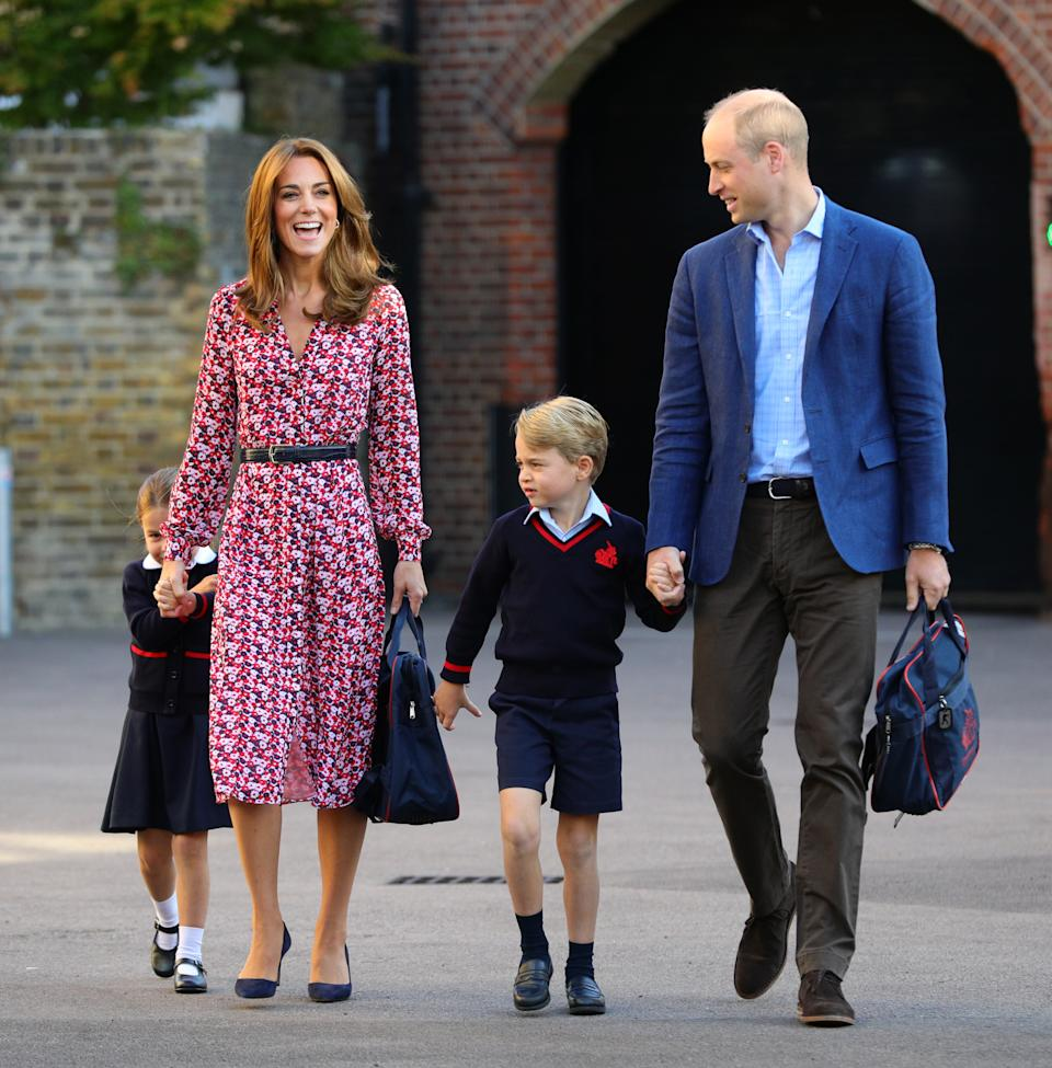 LONDON, UNITED KINGDOM - SEPTEMBER 5: Princess Charlotte, hide behind her mother the Duchess of Cambridge as she arrives for her first day at school, with her brother Prince George and her father the Duke of Cambridge at Thomas's Battersea in London on September 5, 2019 in London, England. (Photo by Aaron Chown - WPA Pool/Getty Images)