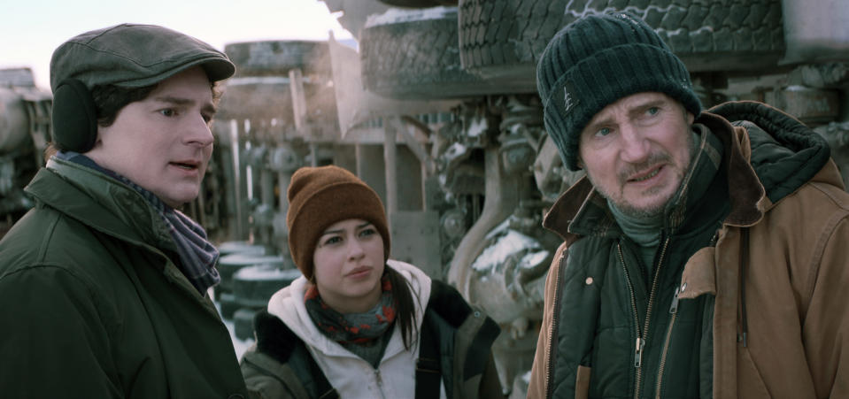 """This image released by Netflix shows Benjamin Walker, from left, Amber Midthunder and Liam Neeson in a scene from """"The Ice Road."""" (Netflix via AP)"""