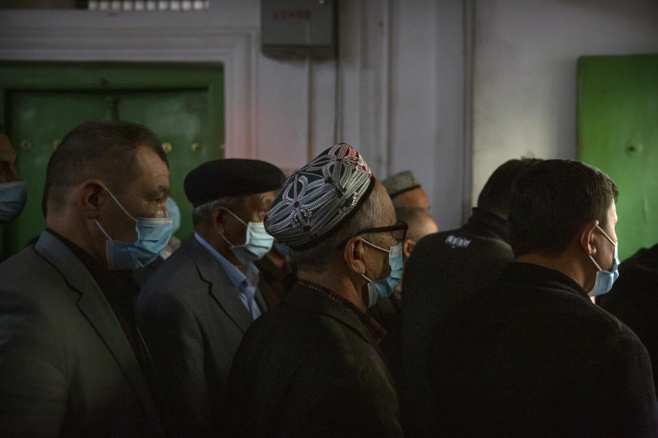 Uyghurs and other members of the faithful leave after prayers at the Id Kah Mosque in Kashgar in western China's Xinjiang Uyghur Autonomous Region, as seen during a government organized trip for foreign journalists, Monday, April 19, 2021. A human rights group is appealing to the United Nations to investigate allegations China's government is committing crimes against humanity in the Xinjiang region. Human Rights Watch cited reports of the mass detention of Muslims, a crackdown on religious practices and other measures against minorities in the northwestern region. (AP Photo/Mark Schiefelbein)