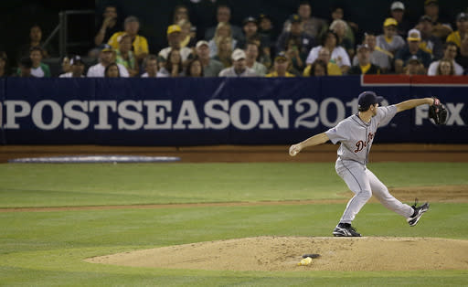 Detroit Tigers pitcher Justin Verlander throws to an Oakland Athletics batter during the fourth inning of Game 2 of an American League baseball division series in Oakland, Calif., Saturday, Oct. 5, 2013. (AP Photo/Jeff Chiu)