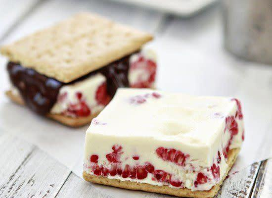 """Fresh raspberries dress up vanilla ice cream, making it just that much more enticing to sandwich between two cookies. <strong>Get the <a href=""""http://www.goodlifeeats.com/2012/05/raspberry-ice-cream-sandwiches.html"""" rel=""""nofollow noopener"""" target=""""_blank"""" data-ylk=""""slk:Raspberry Ice Cream Sandwiches recipe"""" class=""""link rapid-noclick-resp"""">Raspberry Ice Cream Sandwiches recipe</a> by Good Life Eats</strong>"""
