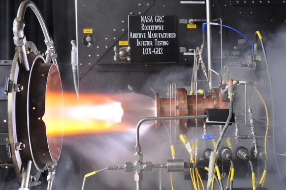 A liquid oxygen/gaseous hydrogen rocket injector assembly built using 3D printing technology is hot-fire tested at NASA Glenn Research Center's Rocket Combustion Laboratory in Cleveland, Ohio.