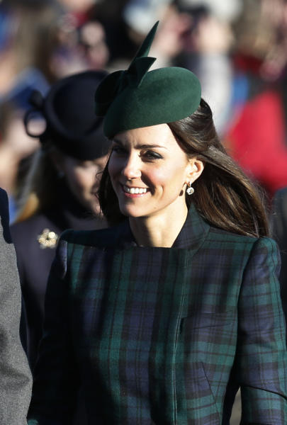 Kate the Duchess of Cambridge arrives to attend a Christmas Day Service with other members of the royal family at St. Mary's church on the grounds of Sandringham Estate, the Queen's royal estate in Norfolk, England, Wednesday, Dec. 25, 2013. (AP Photo/Lefteris Pitarakis)