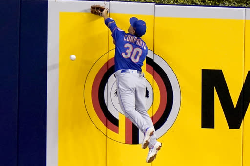 New York Mets right fielder Michael Conforto (30) can't get to a double hit by Miami Marlins' Matt Joyce during the fourth inning of a baseball game, Tuesday, Aug. 18, 2020, in Miami. (AP Photo/Lynne Sladky)