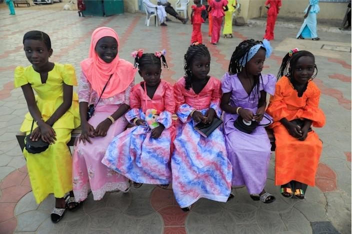 On the same day in Senegal's capital Dakar, these girls wear bright and beautiful dresses for Eid al-Adha celebrations
